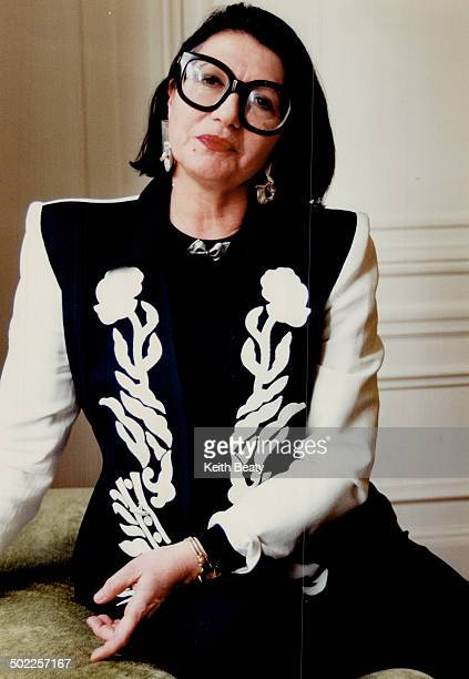 Emmanuelle Khanh in an appliqued suit from her spring line wearing the famous glasses she created in 1971 They launched a revolution in fashion...