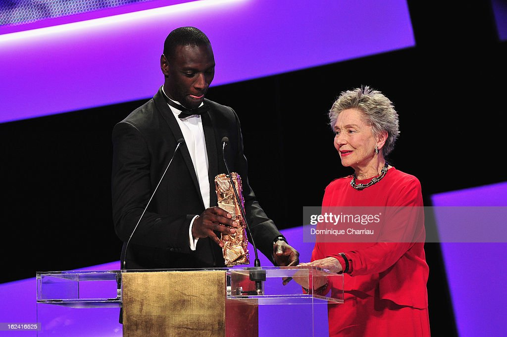 Emmanuelle Riva (R) receives from Omar Sy the Best Actress Cesar for 'Amour' during the 37th Cesar Film Awards Cesar Film Awards 2013 at Theatre du Chatelet on February 22, 2013 in Paris, France.