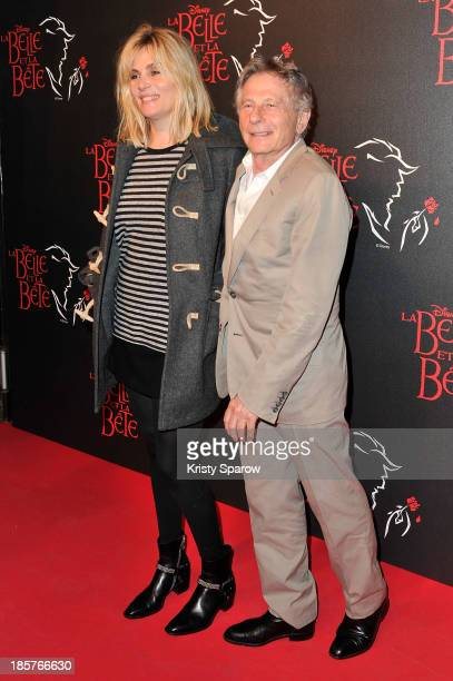 Emmanuelle Seigner and Roman Polanski attend the 'Beauty and the Beast' Paris Premiere at Theatre Mogador on October 24 2013 in Paris France