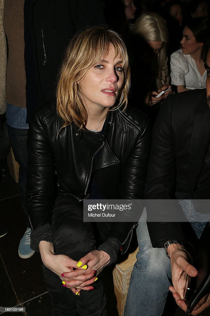 <a gi-track='captionPersonalityLinkClicked' href=/galleries/search?phrase=Emmanuelle+Seigner&family=editorial&specificpeople=240590 ng-click='$event.stopPropagation()'>Emmanuelle Seigner</a> attends the Saint Laurent Fall/Winter 2013 Ready-to-Wear show as part of Paris Fashion Week on March 4, 2013 in Paris, France.