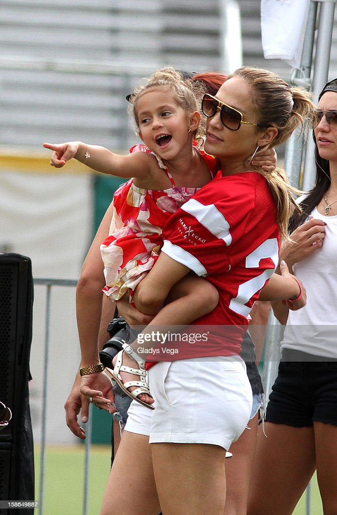 Emme Muniz and <a gi-track='captionPersonalityLinkClicked' href=/galleries/search?phrase=Jennifer+Lopez&family=editorial&specificpeople=201784 ng-click='$event.stopPropagation()'>Jennifer Lopez</a> attend the Pre-Concert Celebrity Football Game Benefiting Hurricane Sandy Relief at Hiram Bithorn Stadium on December 22, 2012 in San Juan, Puerto Rico.