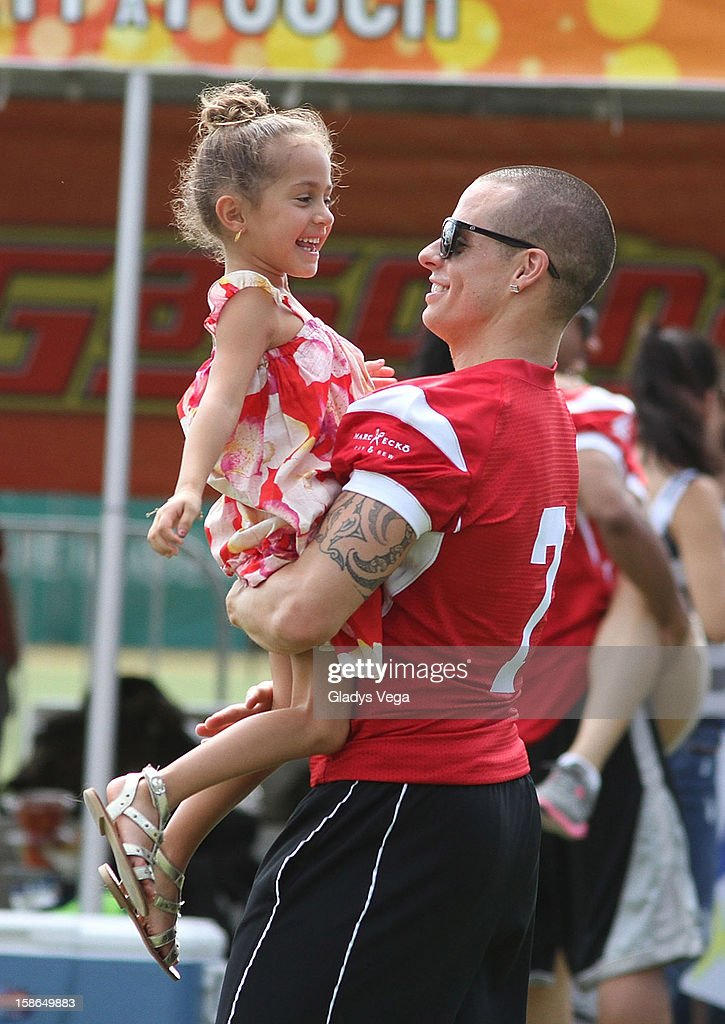 Emme Muniz, Jennifer Lopez's daughter and <a gi-track='captionPersonalityLinkClicked' href=/galleries/search?phrase=Casper+Smart&family=editorial&specificpeople=7596672 ng-click='$event.stopPropagation()'>Casper Smart</a> attend the Pre-Concert Celebrity Football Game Benefiting Hurricane Sandy Relief at Hiram Bithorn Stadium on December 22, 2012 in San Juan, Puerto Rico.