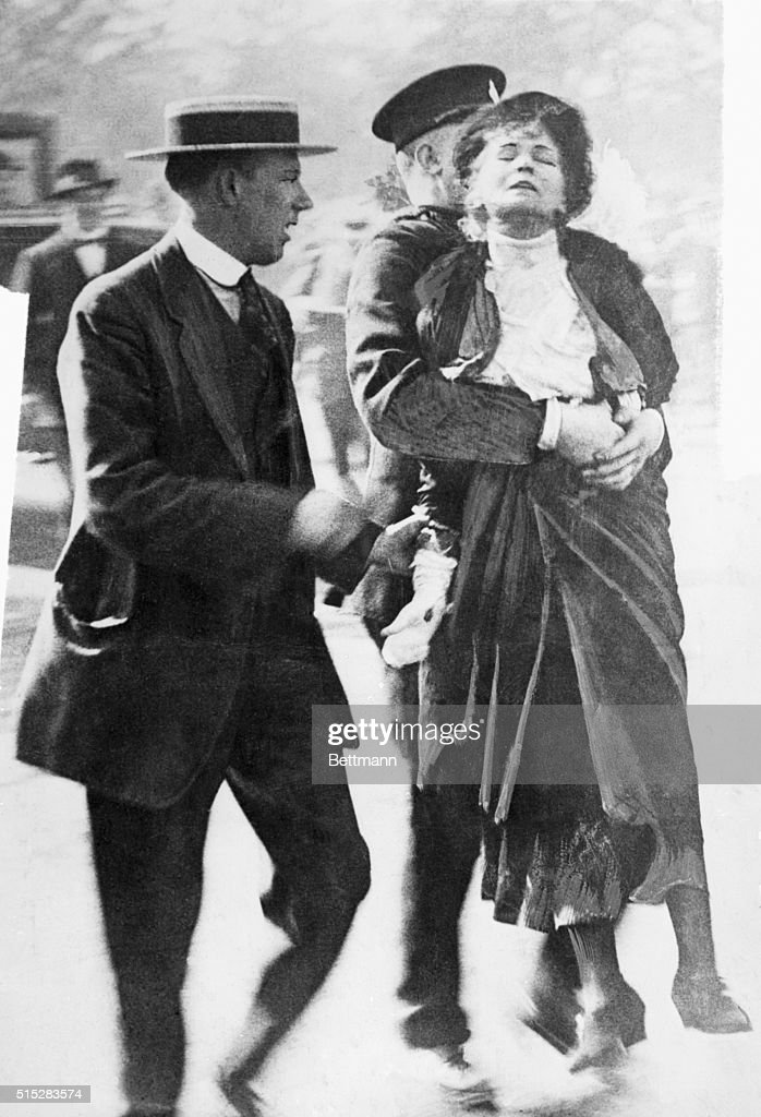 <a gi-track='captionPersonalityLinkClicked' href=/galleries/search?phrase=Emmeline+Pankhurst&family=editorial&specificpeople=226667 ng-click='$event.stopPropagation()'>Emmeline Pankhurst</a> is led away by a policeman after leading a group of suffragettes in an attempt to present a petition to the King at Buckingham Palace.