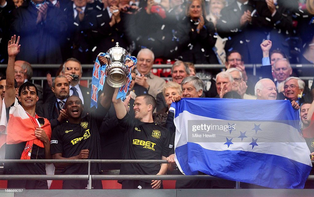 Emmerson Boyce (L) and Gary Caldwell (R) of Wigan Athletic lift the trophy following their team's 1-0 victory during the FA Cup with Budweiser Final between Manchester City and Wigan Athletic at Wembley Stadium on May 11, 2013 in London, England.