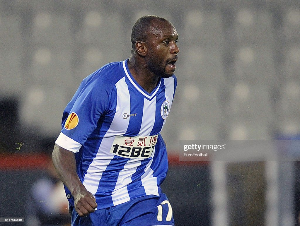 <a gi-track='captionPersonalityLinkClicked' href=/galleries/search?phrase=Emmerson+Boyce&family=editorial&specificpeople=224080 ng-click='$event.stopPropagation()'>Emmerson Boyce</a> of Wigan Athletic FC in action during the UEFA Europa League group stage match between SV Zulte Waregem and Wigan Athletic FC held on September 19, 2013 at the Jan Breydelstadion in Bruges, Belgium.