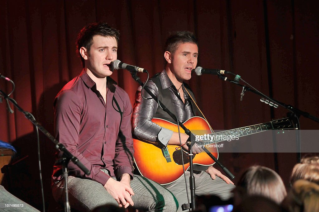Emmet Cahill (L) and Neil Byrne of Celtic Thunder perform during an unplugged concert benefitting Hurricane Sandy victims at Sullivan Hall on December 3, 2012 in New York City.