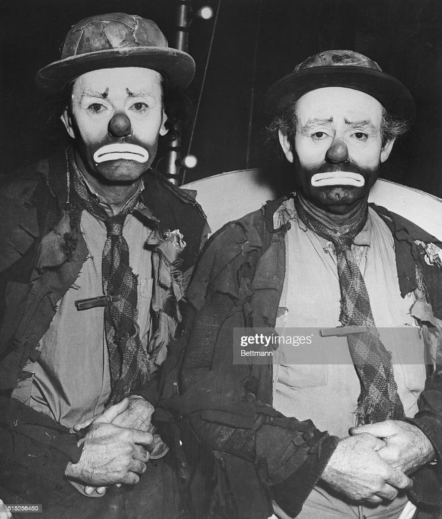 Emmett Kelly noted for his role of the sad clown in the Ringling Brothers Barnum Bailey Circus is matched for costume and makeup by actor Henry Fonda...