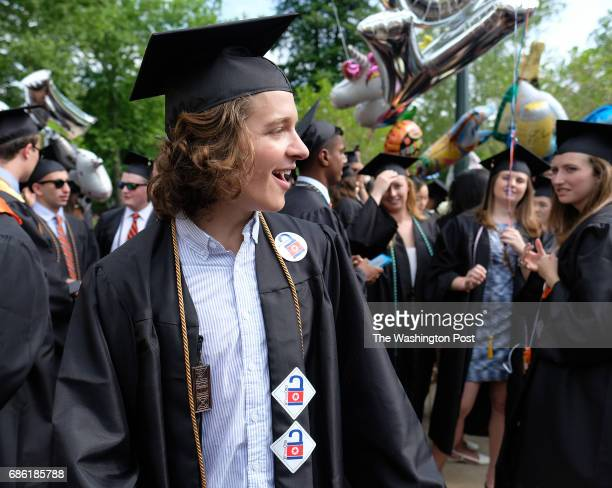 Emmett Saulnier of Cincinnati celebrates graduation at the University of Virginia Sat May 20 2017 while remembering his friend Otto Warmbier who is...