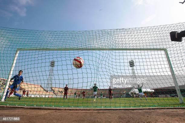 Emmis Rodriguez of Venezuela receives a goal of Alexis Carrasco of Bolivia during a soccer U18 event as part of the XVII Bolivarian Games Trujillo...