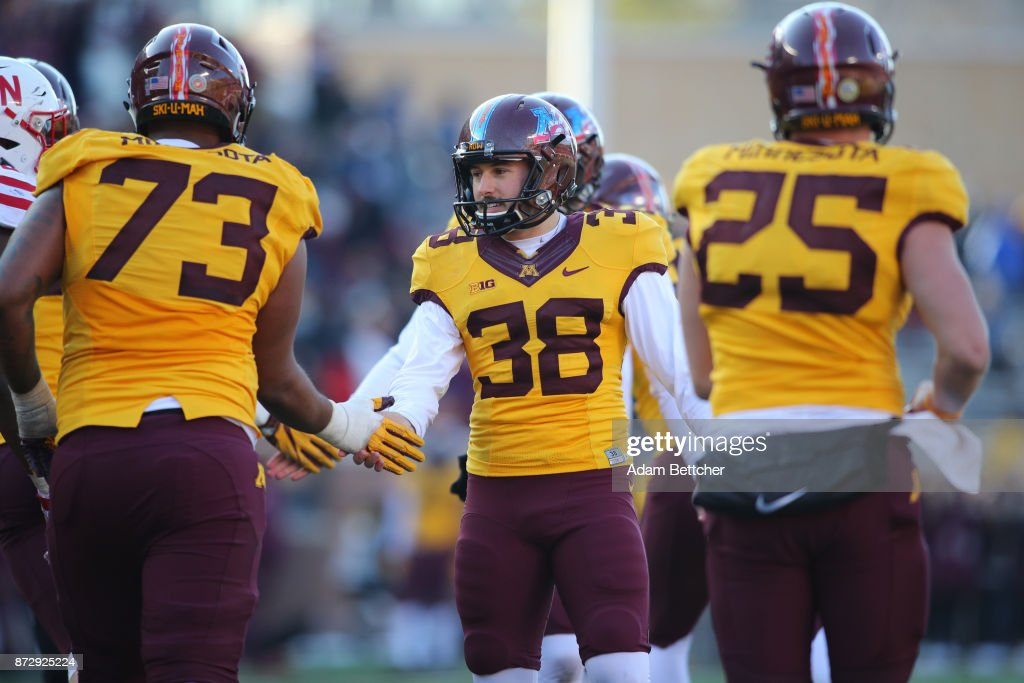 Emmit Carpenter #38 of the Minnesota Golden Gophers celebrates an extra point in the fourth quarter against the Minnesota Golden Gophers at TCF Bank Stadium on November 11, 2017 in Minneapolis, Minnesota. Minnesota defeated Nebraska 54-21.