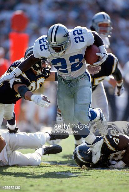 Emmitt Smith of the Dallas Cowboys carries the ball against the San Diego Chargers during an NFL football game October 15 1995 at Jack Murphy Stadium...
