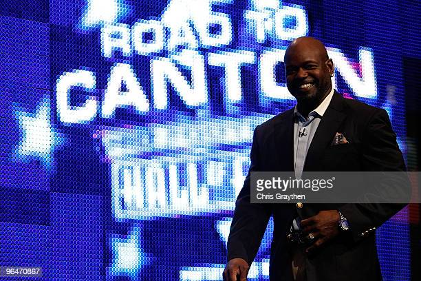 Emmitt Smith smiles as he walks on the stage after being announced as one of the newest enhrinees into the Hall of Fame during the Pro Football Hall...