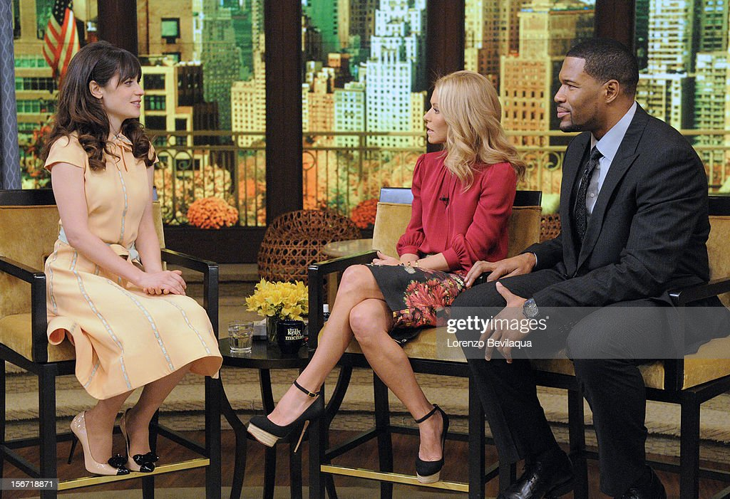 MICHAEL -11/16/12 - Emmy Award-nominated actress Zooey Deschanel chats about the series ÒNew GirlÓ on the newly-rechristened syndicated talk show, LIVE with Kelly and Michael,' distributed by Disney-ABC Domestic Television. (Photo by Lorenzo Bevilaqua/Disney-ABC via Getty Images) ZOOEY DESCHANEL, KELLY RIPA, MICHAEL STRAHAN