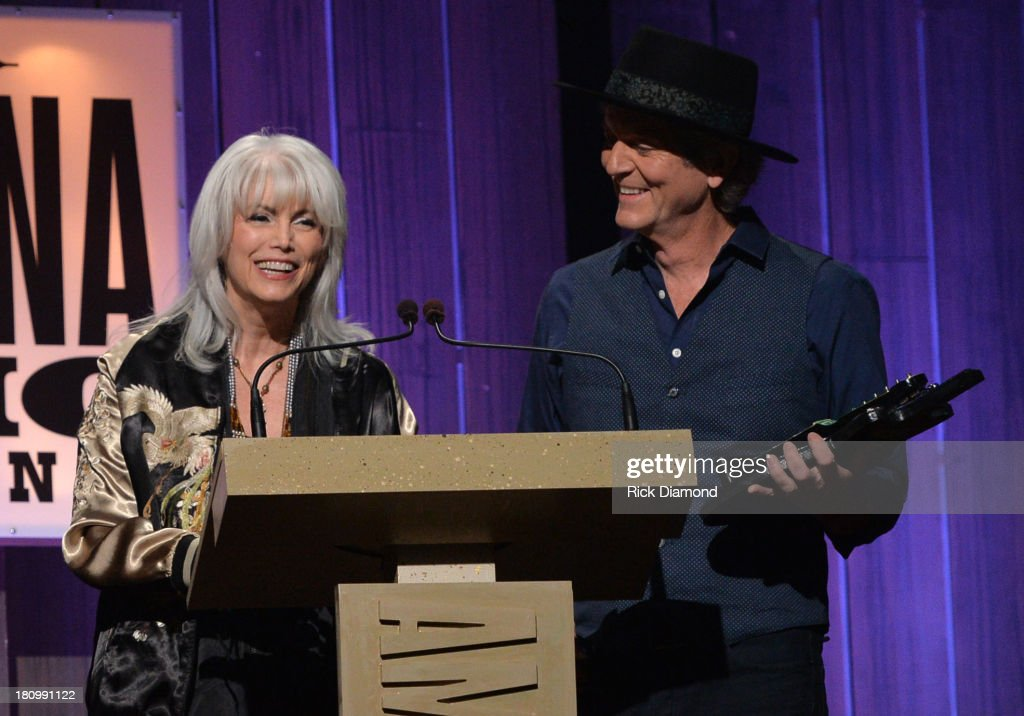 Emmy Lou Harris and <a gi-track='captionPersonalityLinkClicked' href=/galleries/search?phrase=Rodney+Crowell&family=editorial&specificpeople=653146 ng-click='$event.stopPropagation()'>Rodney Crowell</a> present at the 12th Annual Americana Music Honors And Awards Ceremony Presented By Nissan on September 18, 2013 in Nashville, Tennessee.