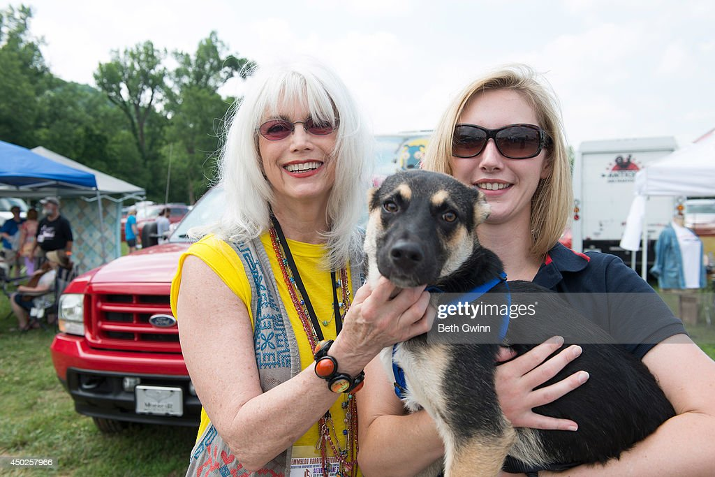 Emmy Lou Harris, Sochi the dog adopted during the winter olympics in Sochi, Russia, and Amanda Bird Woofstock at Fontanel 2014 on June 7, 2014 in Nashville, Tennessee.