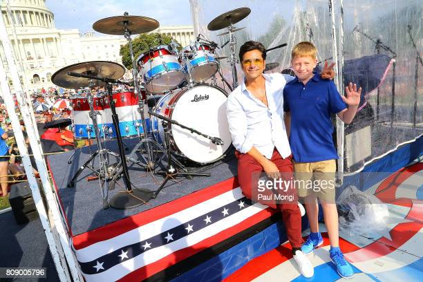 Emmy nominated actor John Stamos donates a speciallymade Ludwig drum kit to Owen Schneider the son of a US Marine veteran at PBS's A Capitol Fourth...
