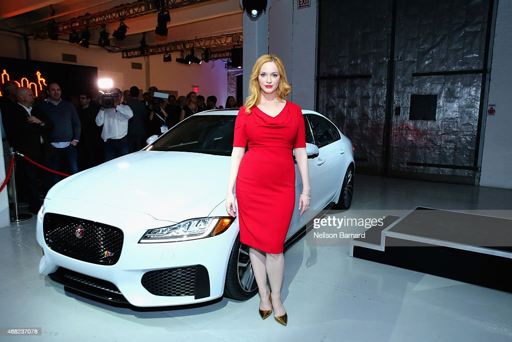 Emmy® nominated actress Christina Hendricks with the all-new Jaguar XF at Jaguar Land Rover's exclusive reception to celebrate the 2015 New York International Auto Show at Center548 in New York City on March 31, 2015 in New York City.