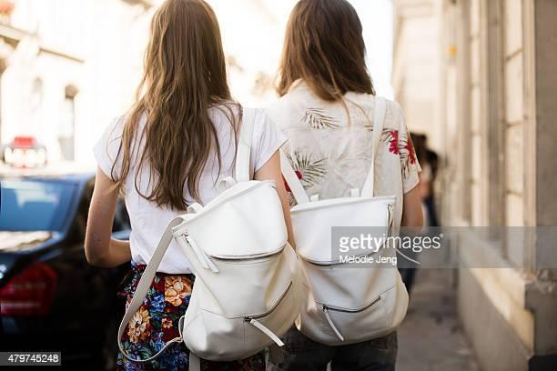 Emmy Rappe and Hedvig Palm wear Derek Lam backpacks on July 6 2015 in Paris France