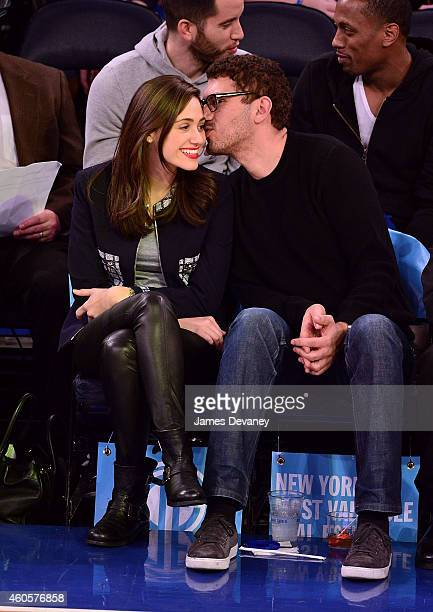 Emmy Rossum and guest attend New York Knicks vs Dallas Mavericks game at Madison Square Garden on December 16 2014 in New York City