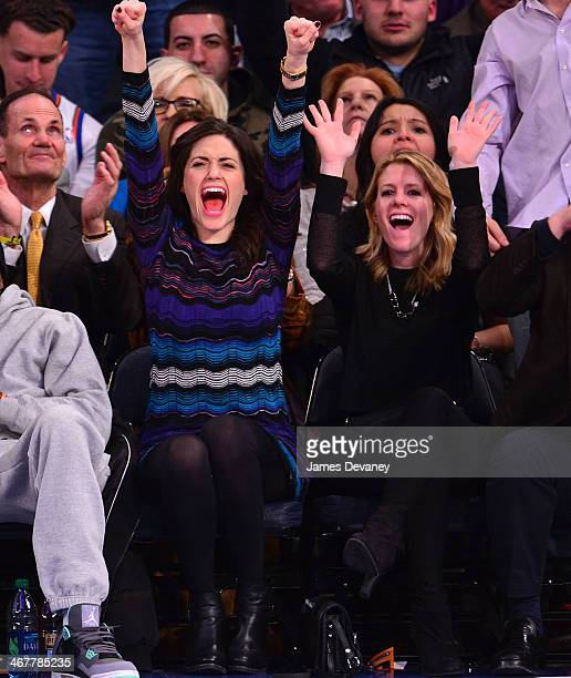 Emmy Rossum and guest attend the Denver Nuggets vs New York Knicks game at Madison Square Garden on February 7 2014 in New York City