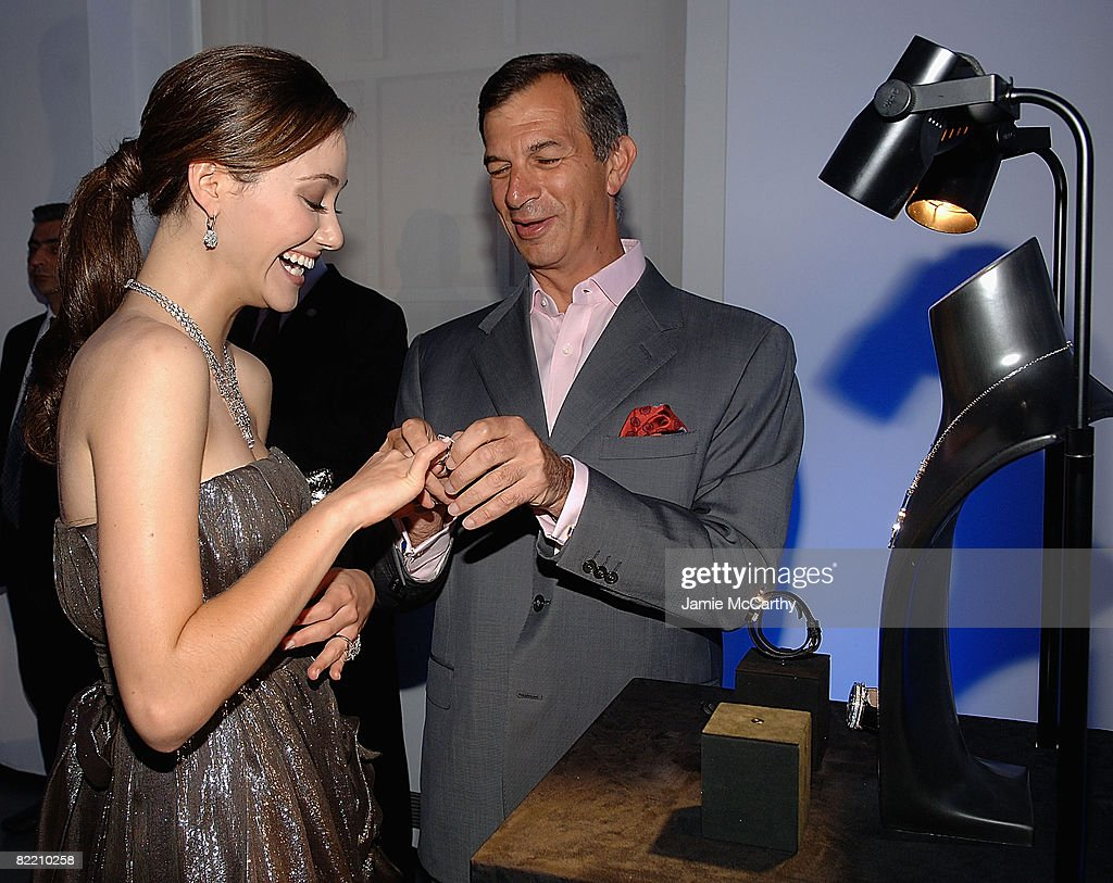 <a gi-track='captionPersonalityLinkClicked' href=/galleries/search?phrase=Emmy+Rossum&family=editorial&specificpeople=202563 ng-click='$event.stopPropagation()'>Emmy Rossum</a> and <a gi-track='captionPersonalityLinkClicked' href=/galleries/search?phrase=Philippe+Leopold-Metzger&family=editorial&specificpeople=4900497 ng-click='$event.stopPropagation()'>Philippe Leopold-Metzger</a>, Piaget CEO attend the Piaget Hosts The Limelight Paris-New York Collection event at The Loft and Garden at Rockefeller Center on August 7, 2008 in New York City.