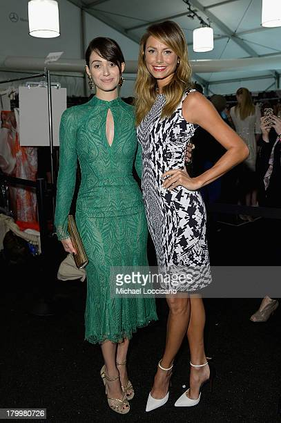 Emmy Rossum and Stacy Keibler pose backstage at the Monique Lhuillier fashion show during MercedesBenz Fashion Week Spring 2014 at The Theatre at...