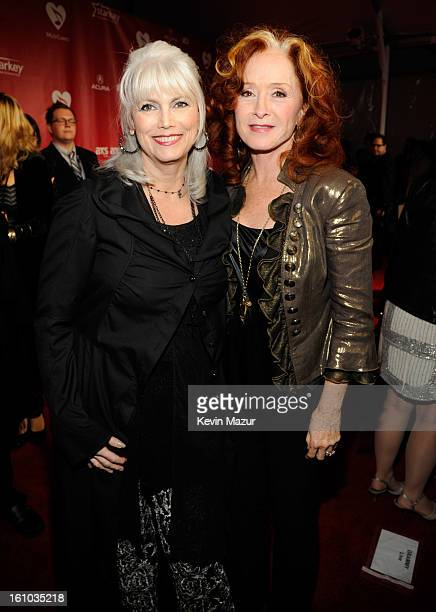 EmmyLou Harris and Bonnie Raitt attend MusiCares Person Of The Year Honoring Bruce Springsteen at Los Angeles Convention Center on February 8 2013 in...