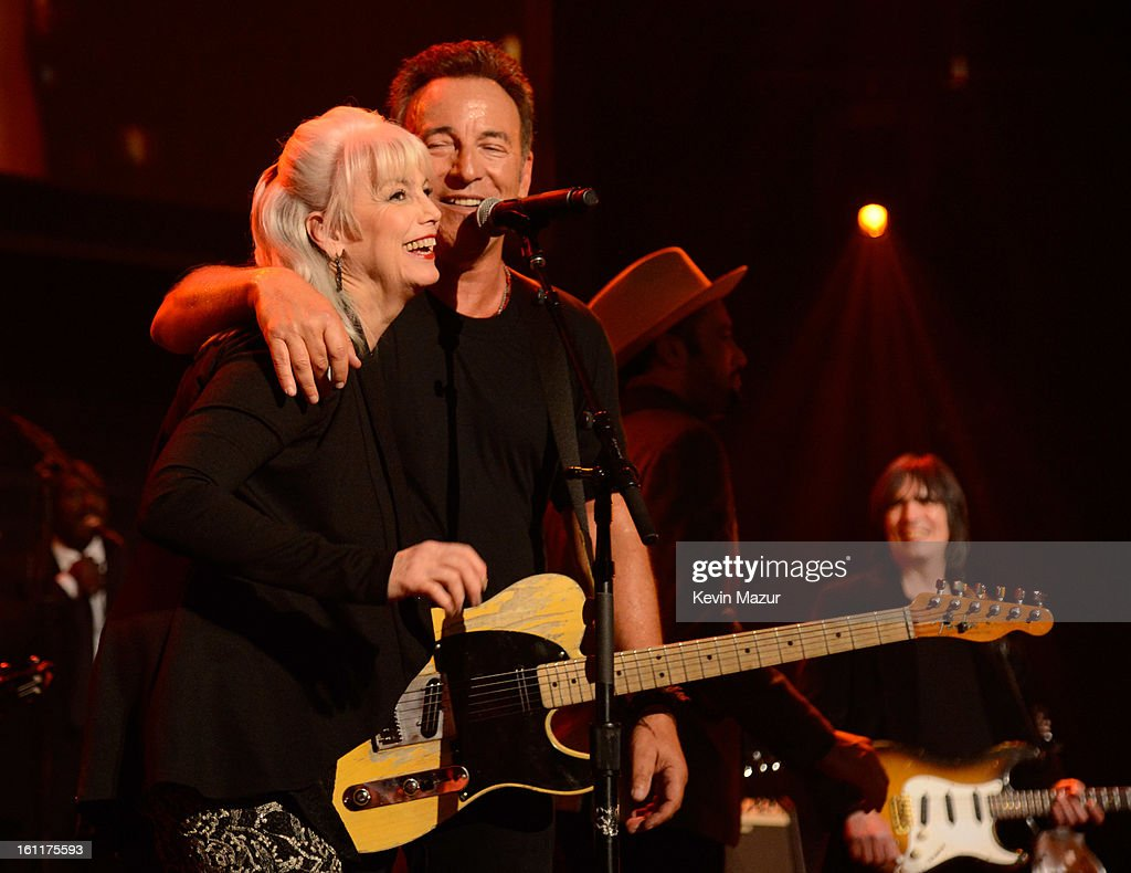 Emmylou Harris and Bruce Springsteen perform onstage at MusiCares Person Of The Year Honoring Bruce Springsteen at Los Angeles Convention Center on February 8, 2013 in Los Angeles, California.