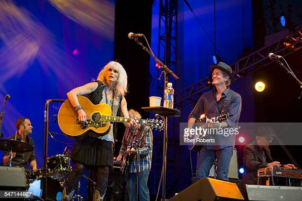 Emmylou Harris and Rodney Crowell perform at Damrosch Park Bandshell at Lincoln Center in New York NY on August 6 2014