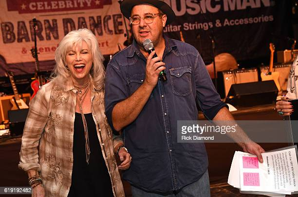 Emmylou Harris and Vince Gill perform as auctioneers during the 2016 Celebrity Barn Dance Benefitting Music Health Alliance at Jaeckle Centre on...