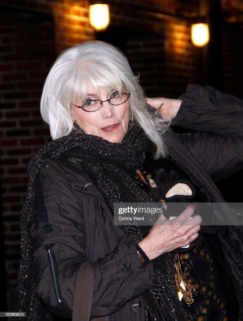 <a gi-track='captionPersonalityLinkClicked' href=/galleries/search?phrase=Emmylou+Harris&family=editorial&specificpeople=240263 ng-click='$event.stopPropagation()'>Emmylou Harris</a> leaves the 'Late Show with David Letterman' at Ed Sullivan Theater on February 25, 2013 in New York City.