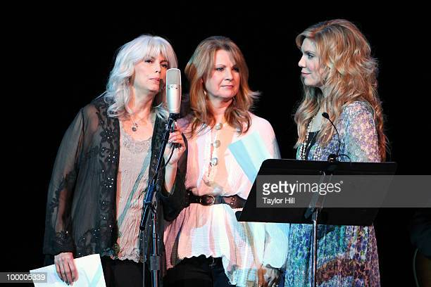 Emmylou Harris Patty Loveless and Allison Krauss performs during the Music Saves Mountains benefit concert at the Ryman Auditorium on May 19 2010 in...