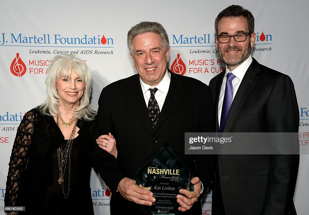 EmmyLou Harris, Tony Martell Outstanding Entertainment Achievement Award honoree Ken Levitan, and Steve Buchanan attend the T.J. Martell Foundation's 7th Annual Nashville Honors Gala at Omni Hotel Downtown on March 30, 2015 in Nashville, Tennessee.