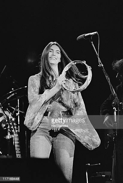 Emmylou Harris US singersongwriter smiling and playing a tambourine on stage during a live concert performance at The Dome in Brighton East Sussex...