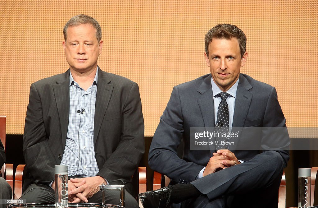 Emmy's writer and producer of 'Late Night With Seth Meyers' Mike Shoemaker and Emmy host Seth Meyers speak onstage at the 'The 66th Primetime Emmy Awards' panel during the NBCUniversal portion of the 2014 Summer Television Critics Association at The Beverly Hilton Hotel on July 13, 2014 in Beverly Hills, California.