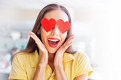"""woman with """"emoji"""" style hearts of her happy face"""