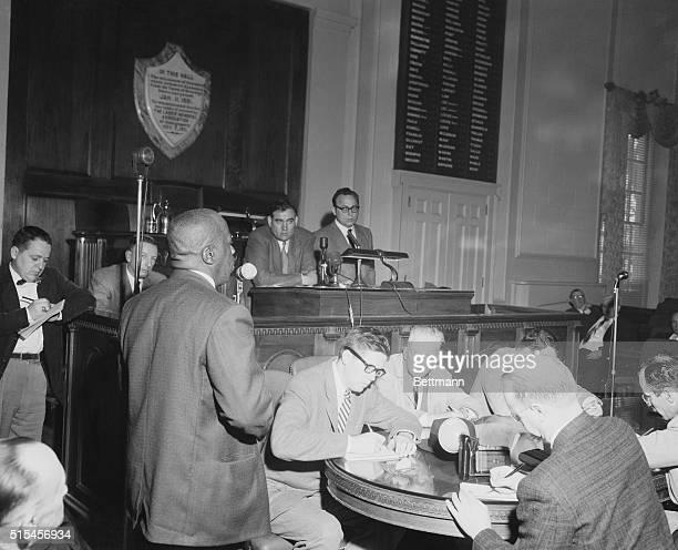 Emory O Jackson managing editor of the Birmingham Alabama World addresses Gov James E Folsom and newsmen assembled at the Alabama Governor's press...