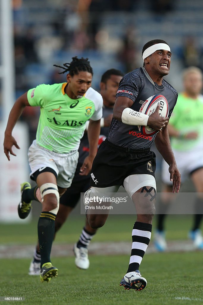 Emosi Mulevoro #6 of Fiji breaks away to score a try against South Africa during the Cup Final at the Tokyo Sevens, in the six round of the HSBC Sevens World Series at the Prince Chichibu Memorial Ground on March 23, 2014 in Tokyo, Japan.