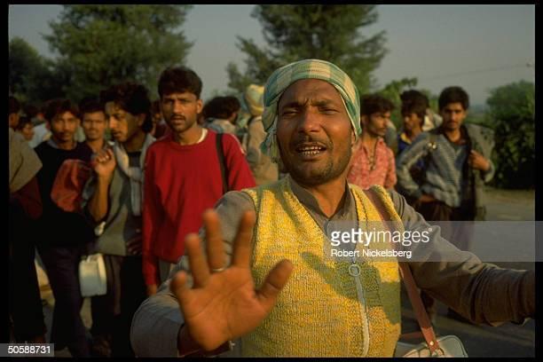 Emoting multitude of militant Hindu activists rioting re razing Muslim mosque Babri Masjid erecting Hindu temple to godking Rama