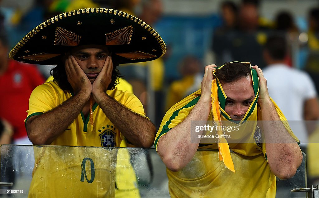 Emotional Brazil fans react after being defeated by Germany 71 during the 2014 FIFA World Cup Brazil Semi Final match between Brazil and Germany at...