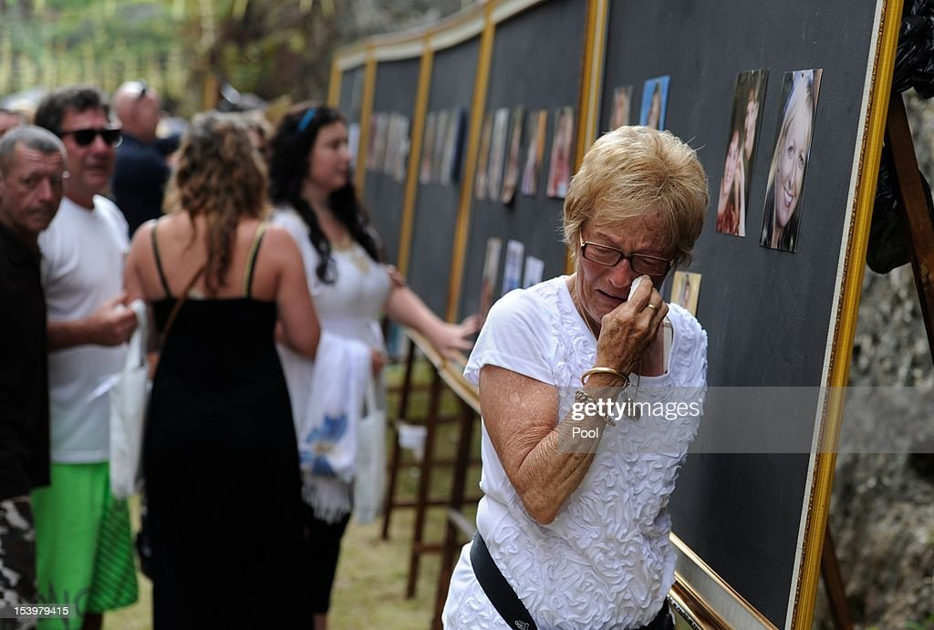 Emotional family members pay their respects at picture boards of the victims during the Bali Bombing 10th anniversary memorial service Garuda Wisnu Kencana on October 12, 2012 in Jimbaran, Bali, Indonesia. Thousands of family members, friends and general public gathered to remember the victims of the 2002 Kuta nightclub bombings which killed 202 people, including 88 Australians.