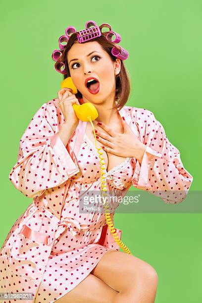Emotional Pin-up Girl with curlers and phone