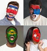 Emotional soccer fans with painted flags of Brazil, Switzerland, Costa Rica and Serbia on faces. Rooters of football worldcup competition between rival countries of group E.
