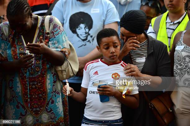 Emotions run high as people attend a candle lit vigil outside Notting Hill Methodist Church near the 24 storey residential Grenfell Tower block in...