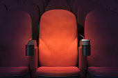 Close up of empty red cinema or theater armchair. Mock up, 3D Rendering