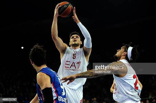 Emperio Armani Milan's Alessandro Gentile vies for the ball with Anadolu Efes' Dario Saric during the Euroleague top 16 basketball match between...