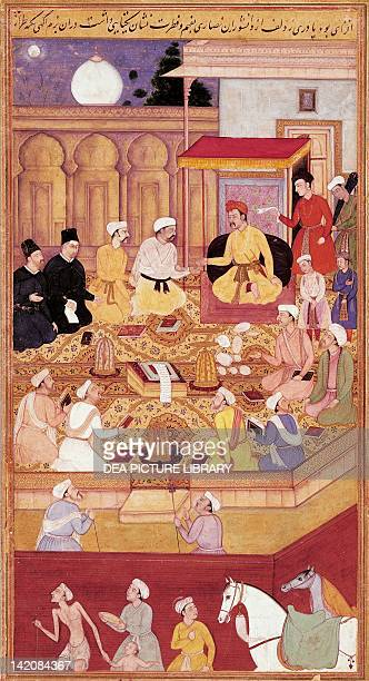 Emperor Akbar in converstion with Jesuit missionaries miniature from the Mughal School India 16th Century