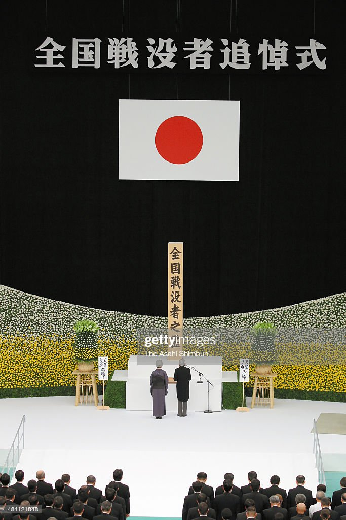 Emperor Akihito addresses while Empress Michiko listens during the memorial service at the Nippon Budokan on the 70th anniversary of the Japan's war surrender on August 15, 2015 in Tokyo, Japan. Emperor Akihito has spoken at the annual ceremony every year since 1989 and past messages have tended to repeat the same phrases. However, at this year's ceremony, Akihito for the first time expressed 'deep remorse over the last war.'