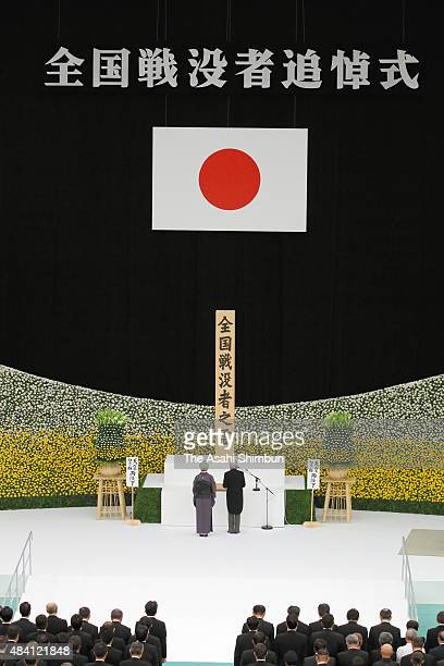 Emperor Akihito addresses while Empress Michiko listens during the memorial service at the Nippon Budokan on the 70th anniversary of the Japan's war...
