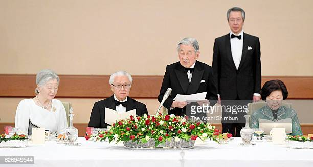 Emperor Akihito addresses while Singapore President Tony Tan his wife Mary and Empress Michiko listen during the state dinner at the Imperial Palace...